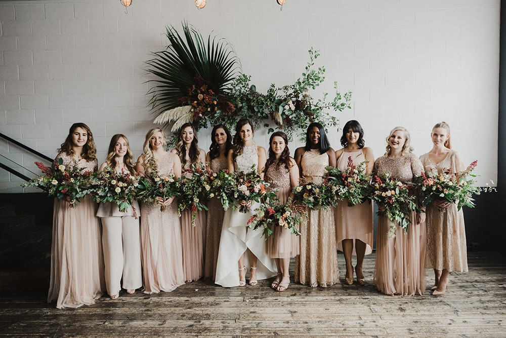 bridesmaids posing for wedding photographer