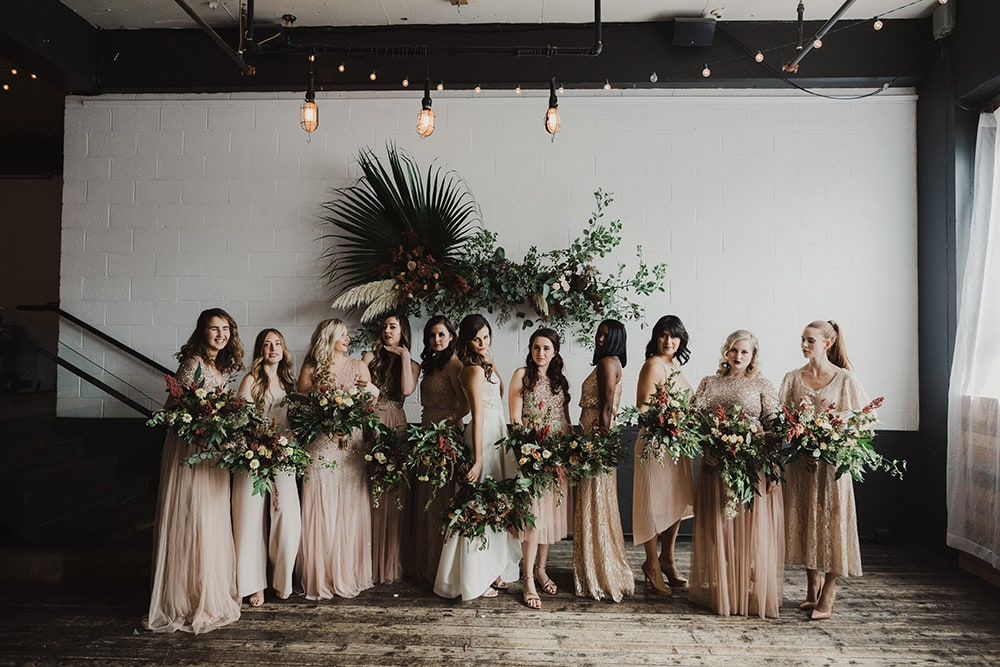 bridesmaids holding bouquets down in pink