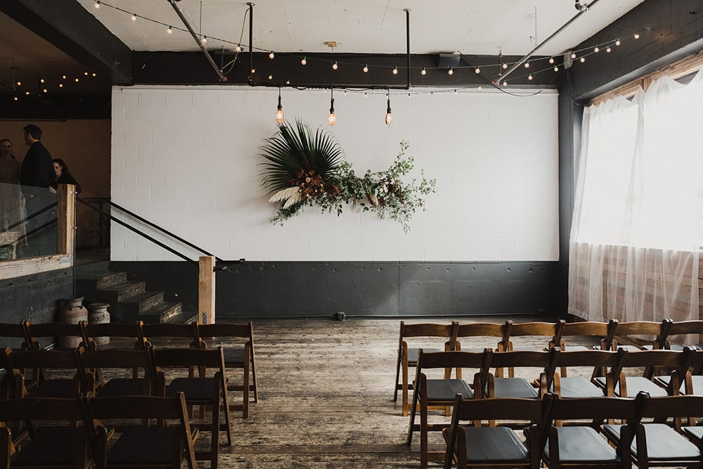 Ceremony backdrop with chairs and unique floral installation at union pine in portland oregon