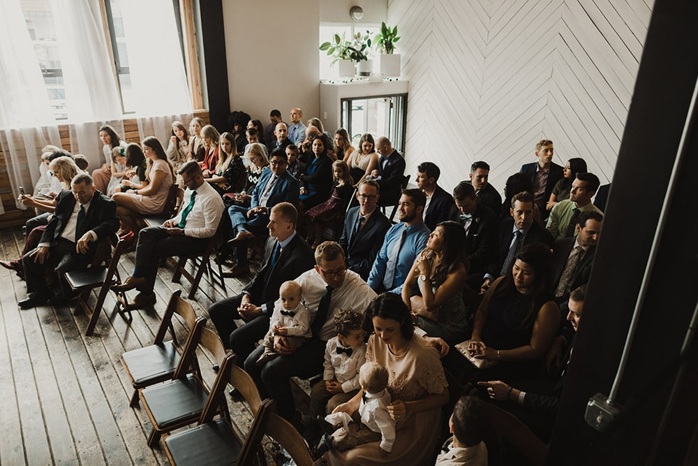 guests sitting in chairs at wedding ceremony