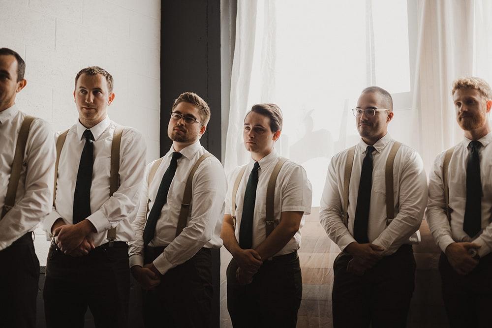 groomsmen looking content and happy