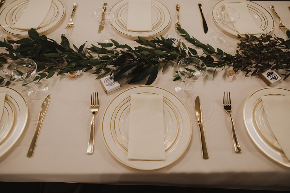 plates and silverware with floral running down table