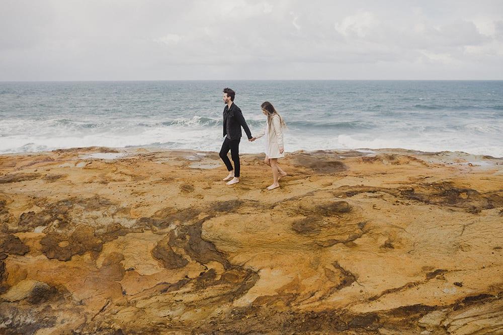 Sandstone at Cape Kiwanda with couple walking