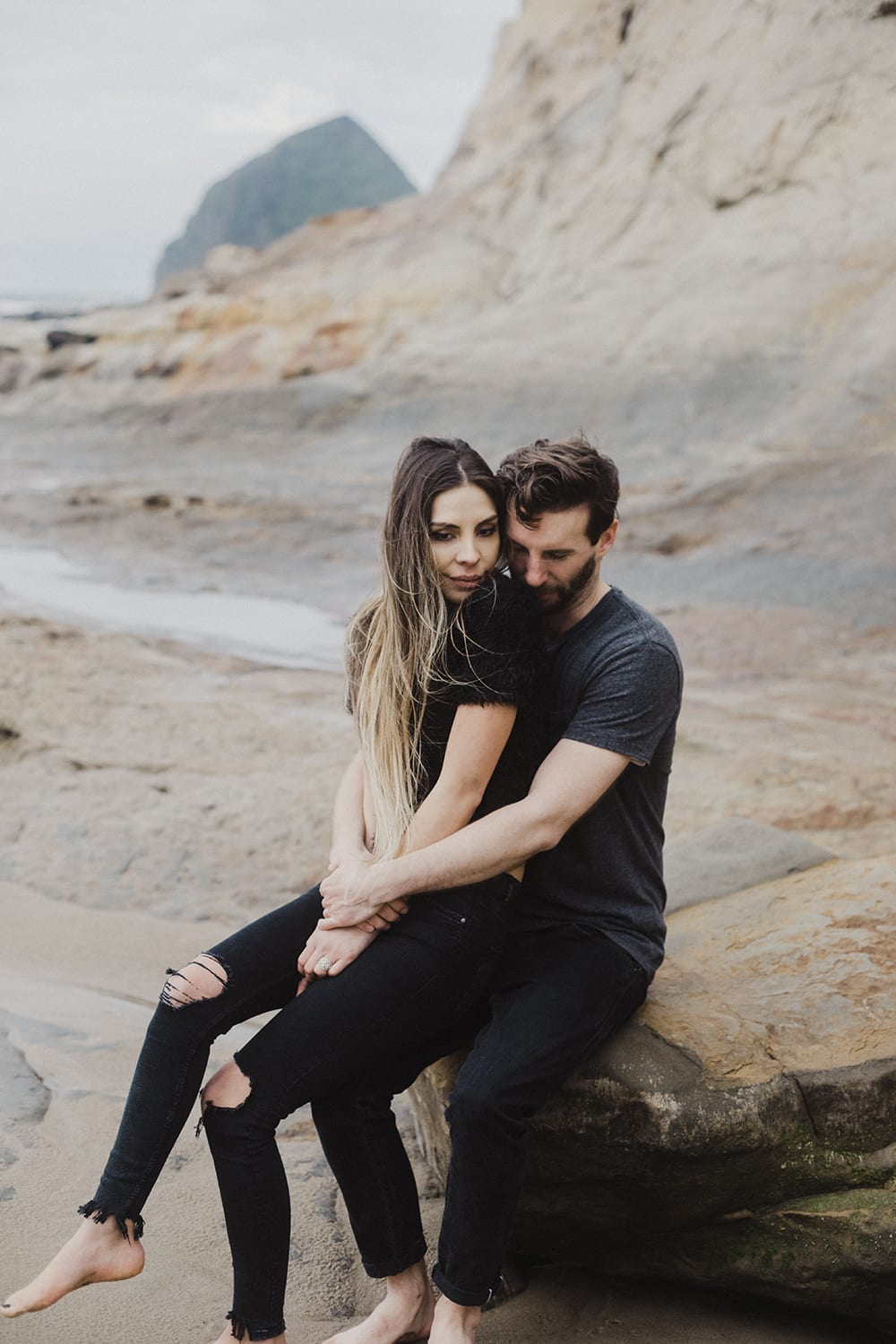 guy squeezing girl in t shirts and ripped jeans