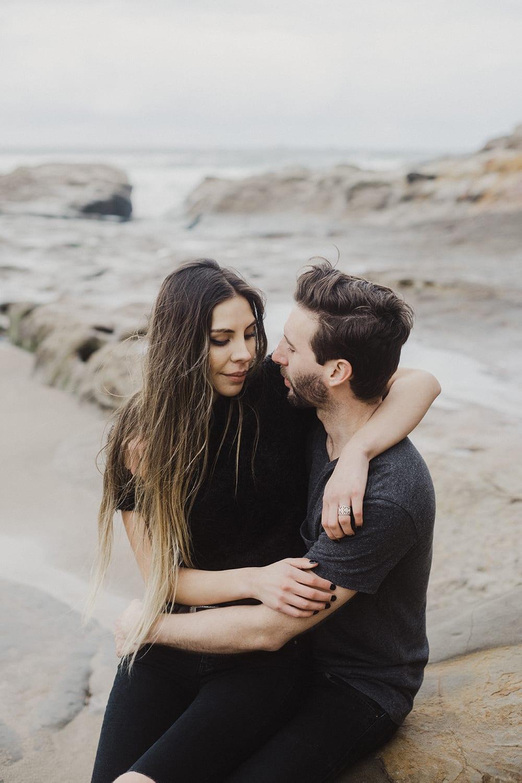 long hair girl arms around guy