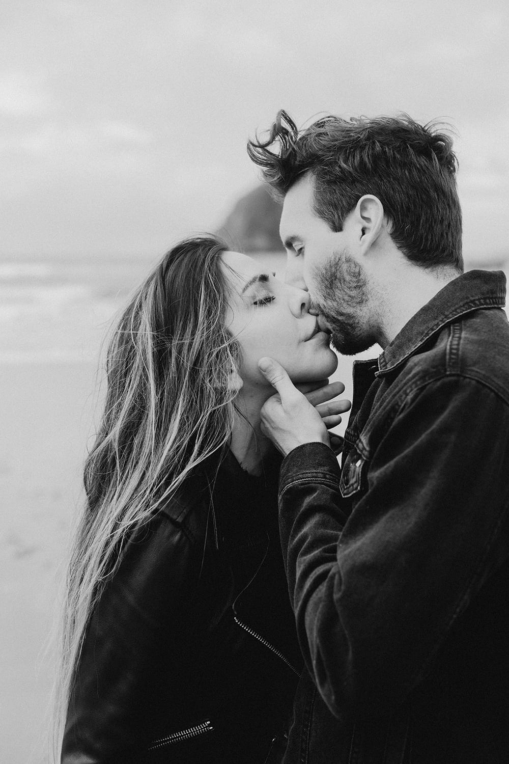 guy kissing girl in black and white photo
