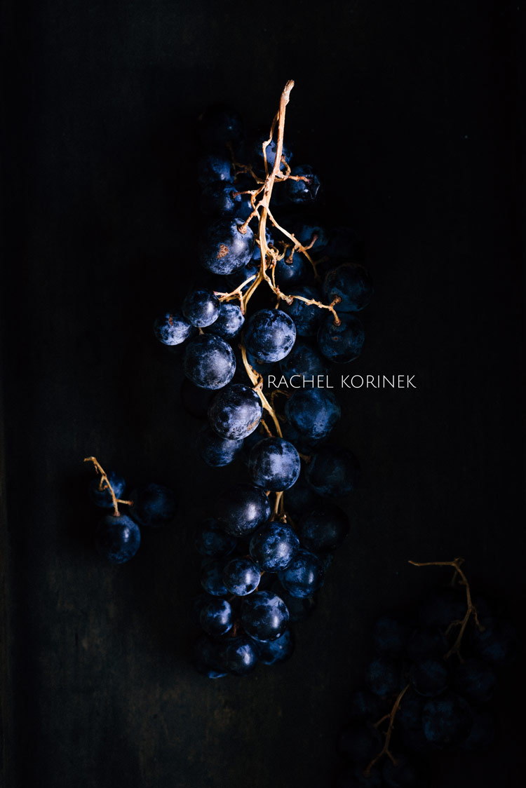Rachel Korinek Food Photographer Dark Moody Grapes  Click to check out my latest food photography projects.  #twolovesstudio #beautifulcuisine #foodbloggerpro #foodphotography #learnfoodphotography #foodblogger #learnphotography #foodstyling #lightingtips #naturallight #foodphotographer