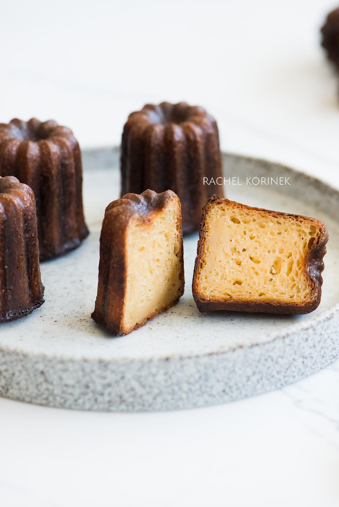 Rachel Korinek Food Photographer | caneles with floot melbourne  Click to check out my latest food photography projects.  #twolovesstudio #beautifulcuisine #foodbloggerpro #foodphotography #learnfoodphotography #foodblogger #learnphotography #foodstyling #lightingtips #naturallight #foodphotographer