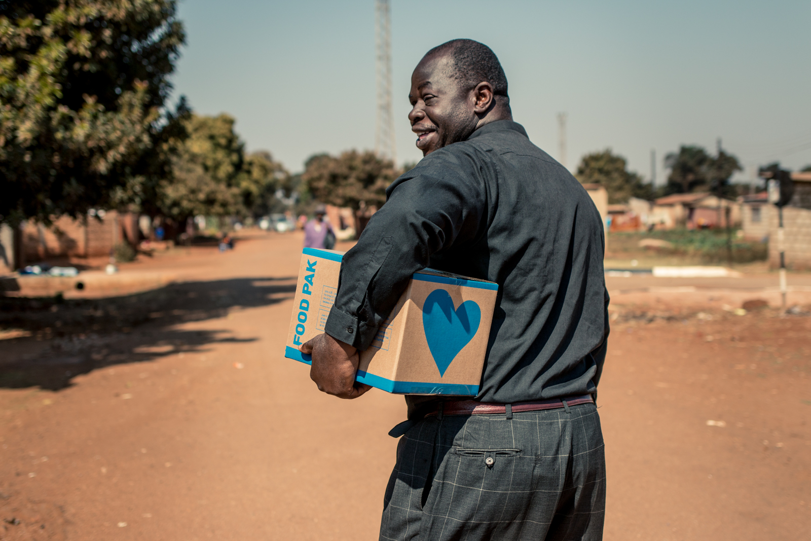 ZIMBABWE: [Home Visit] This is Bishop Musakwa. He's smiling as we walked to his home to share this food box with his family. Many times the pastors themselves are supported by the Food Pak ministry. We encourage the churches to prioritize meeting the needs of their congregations..    ..let us do good to everyone, and especially to those who are of the household of faith. -Gal 6:10
