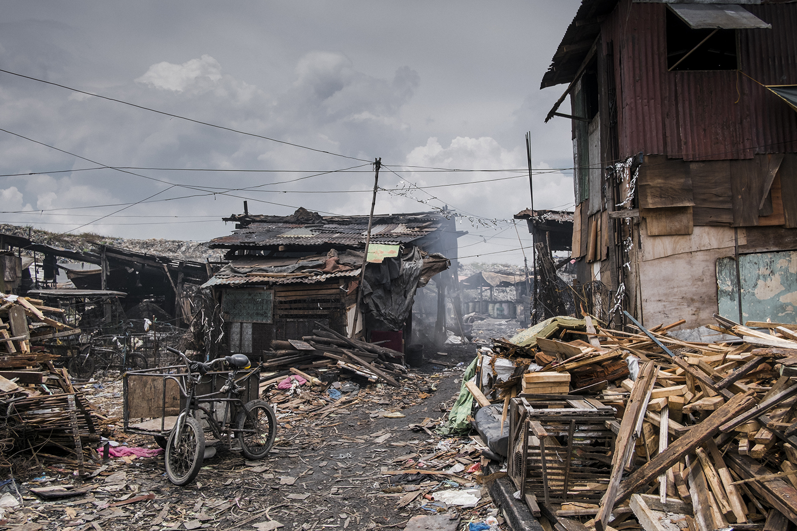 Squatter's area in Malabon City is one of the poorest and most congested slums in Metro Manila. Around 137 thousand people leave here on a surface of around 2,5 square km. Some make they living by producing toxic community made coal, others work in local businesses, as drivers or construction workers. Malabon, Philippines, 2017
