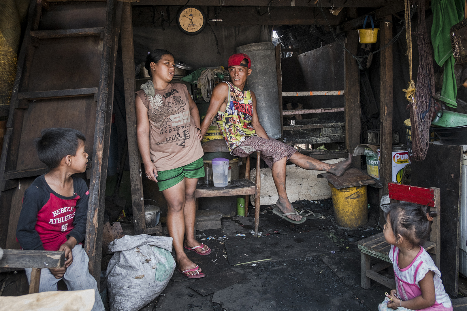 Ricky (30) and Narisa (28) live just beside charcoal open pits. They have two kids and this year they have applied for 4P's Philippine governmental program aiming to eradicate extreme poverty by investing in health and education. They never got a reply. The corruption in local governments in the Philippines is very common and some places for the programmes are already reserved for government member's connections even though they are not the most vulnerable. Malabon, Philippines, 2017