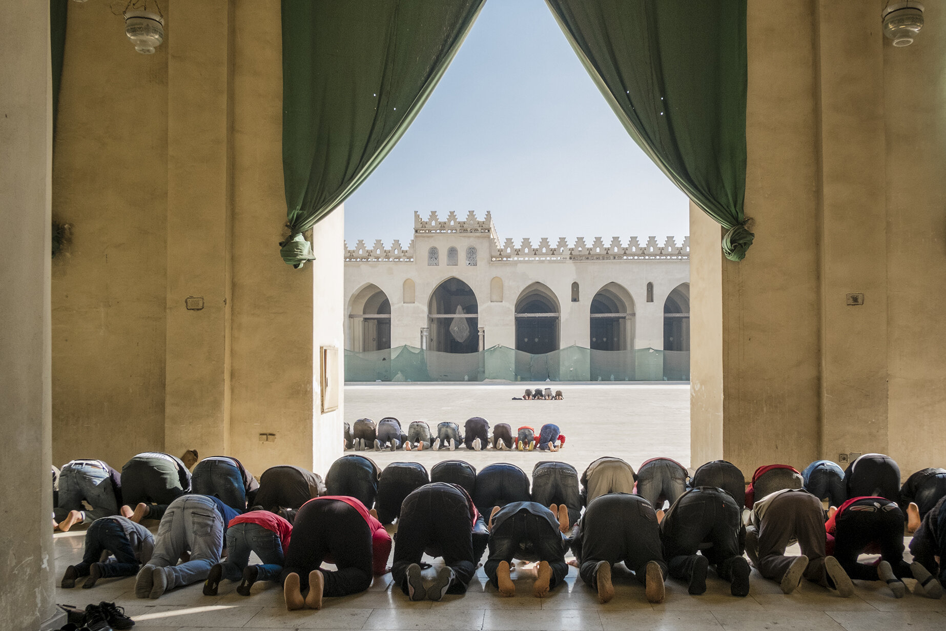 "Men during the most important Friday midday prayer at the Masjid Al Hakim mosque in Islamic Cairo. In Egypt 90% of the population is declared as Muslims, since 1980 Islam is recognized as the official religion and according to the country's constitution,""the principles of Islam Sharia are the principle source of legislation"". January 2019, Cairo, Egypt"