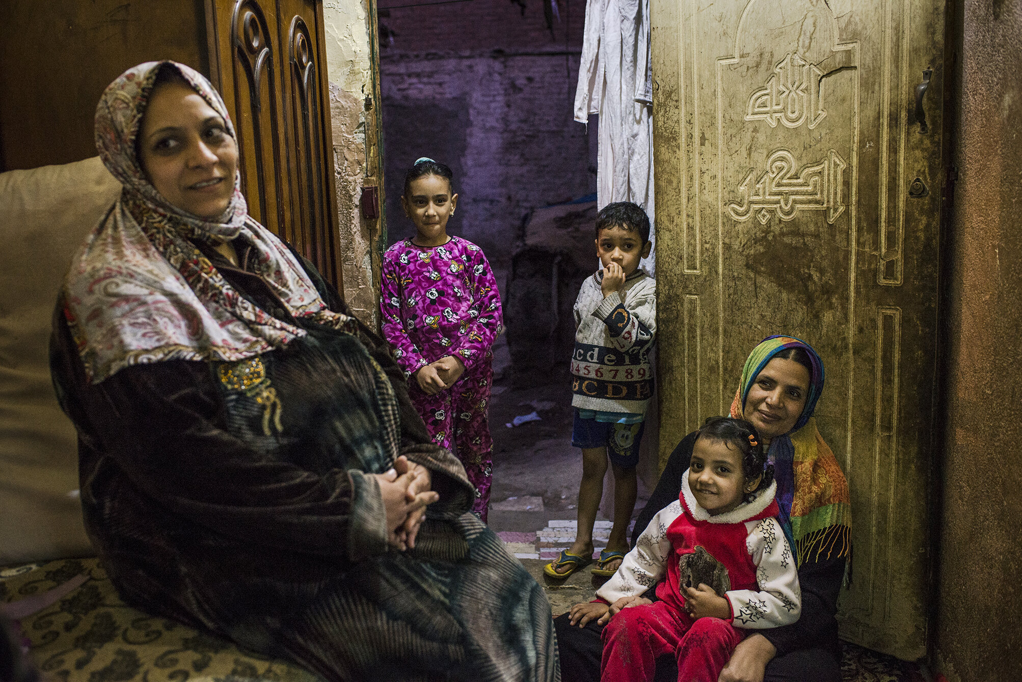 Magda (right) and Abir (left) are neighbours living in a slum area in the central Cairo. Magda works at a local gynaecological clinic and she tries to convince people around her against FGM. Abir however is planning to circumcise her 12 years old daughter. In traditional communities clitoris is perceived as source of desire and excitement; thus; it is necessary to cut it off for the girls to remain morally correct. December 2018; Cairo; Egypt