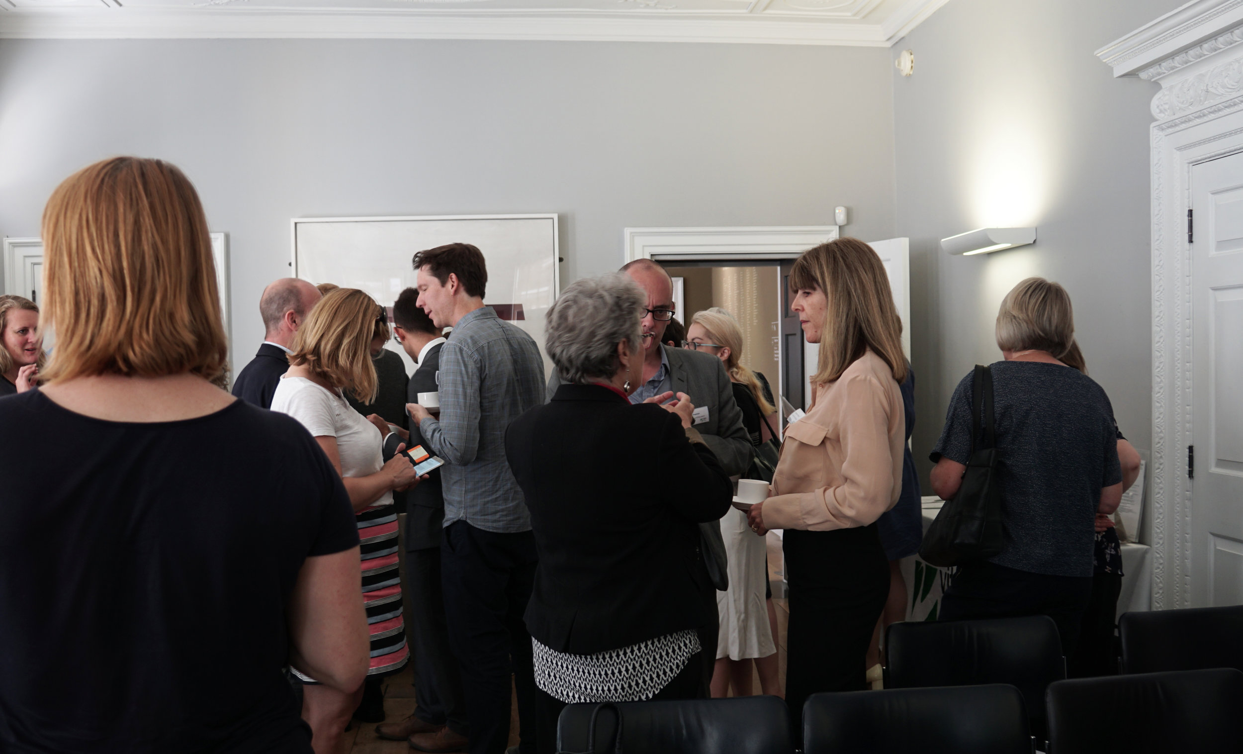 Guests enjoy a drinks reception at the 'One size does not fit all' launch