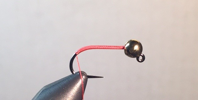 Step 1:  Slide bead on hook and place in vise. Start thread behind bead and wrap slightly down the bend.