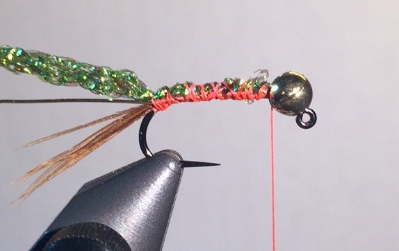 """Step 3:  Tie in a 2"""" section of medium gold wire, and a 2"""" section of green diamond braid."""