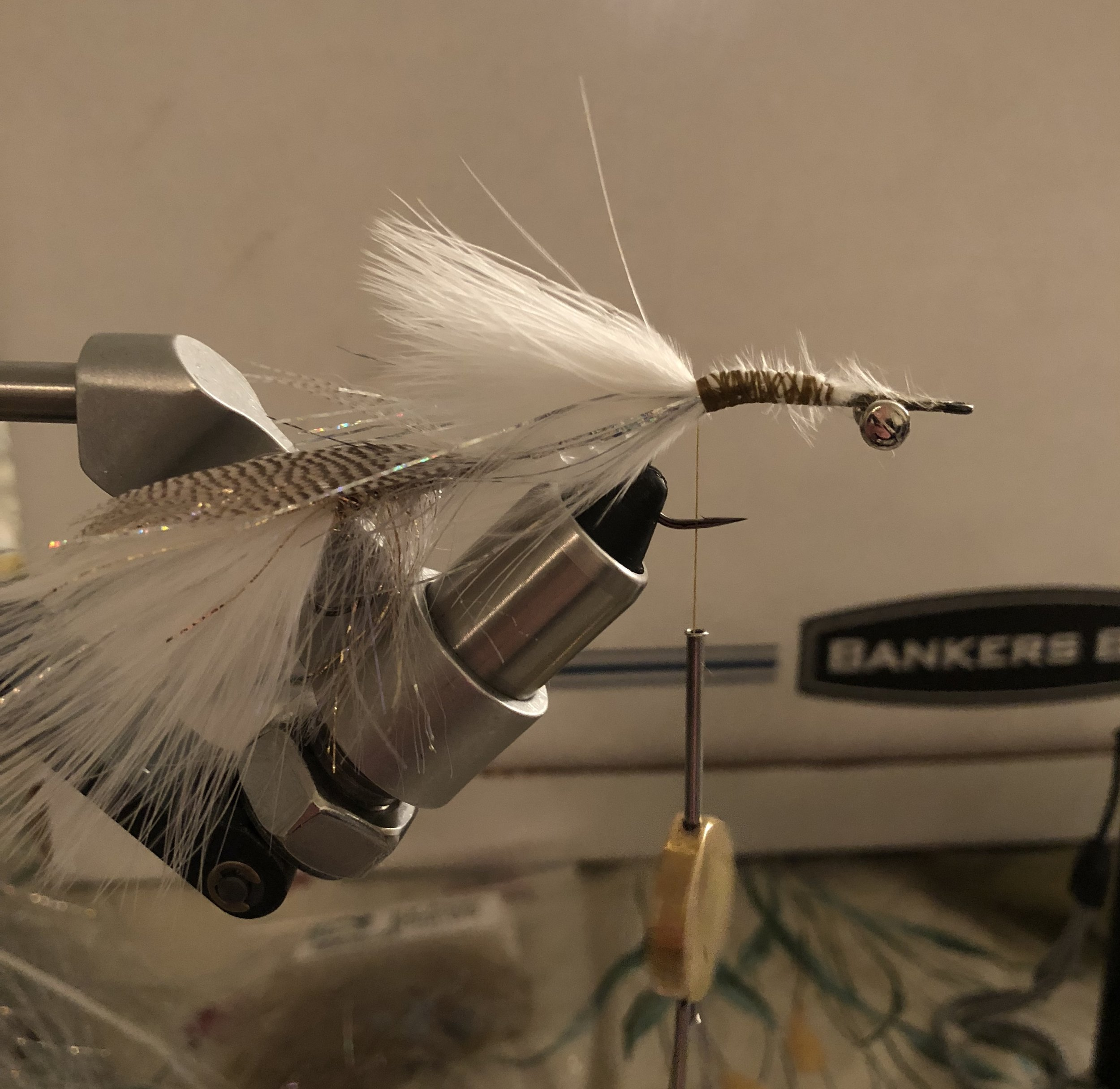Step 7:  Repeat the process that you did for the tail of the fly. Tie in marabou, flash, then another small marabou plume. Now is the time to really build the taper.