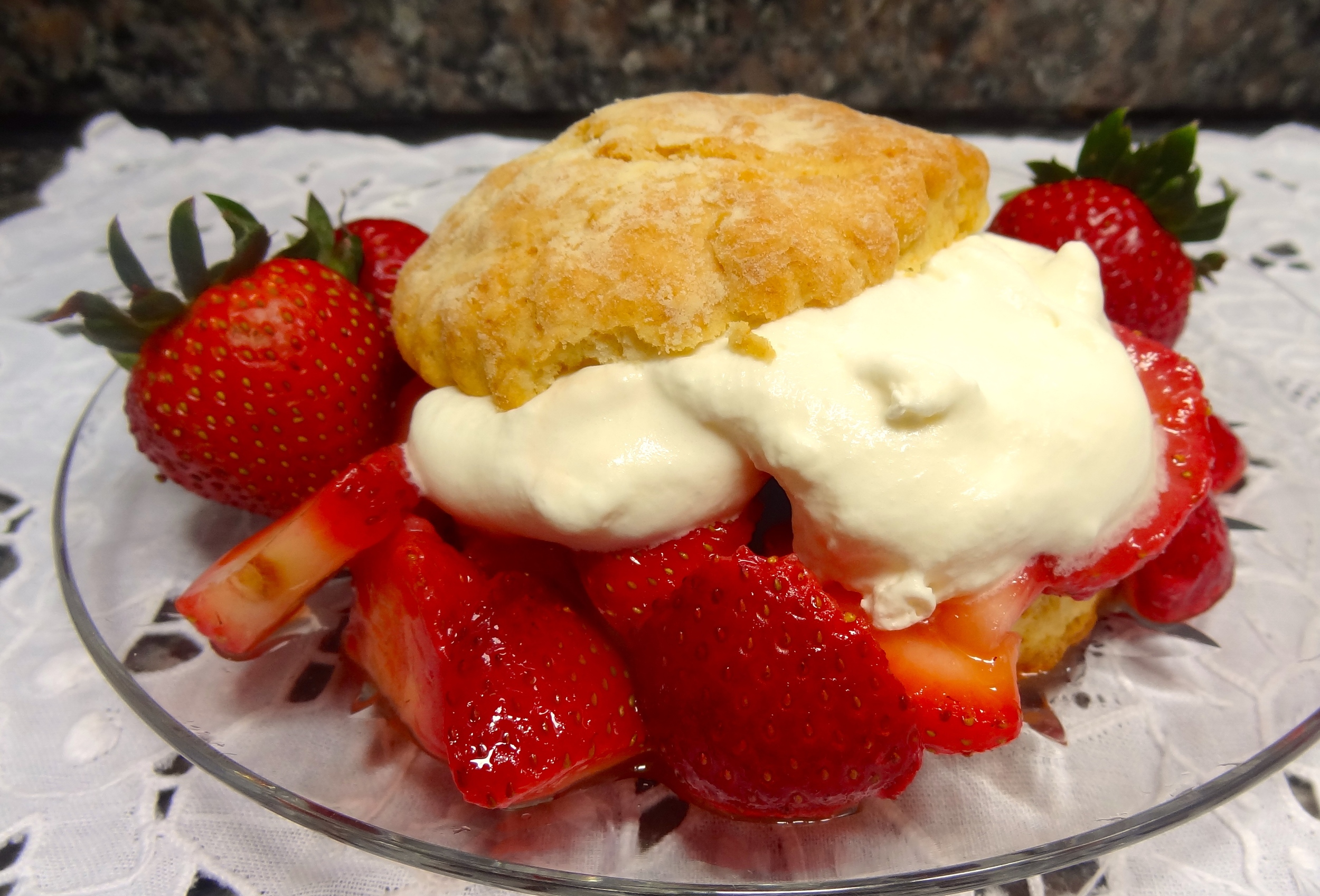 I made the strawberry shortcake for my guests last weekend and even though I bought the berries in a supermarket (no farmer's markets near me open yet), the dessert was a winner and everyone, including the two people on Weight Watchers ate every last crumb.   Adding a little Grand Marnier is a good tip if the berries aren't the absolute best.   I also made the biscuits a little fatter than usual – 7 circles cut out of the dough instead of the usual 8. They were moist and fluffy and took in all the lush strawberry juices and thick, almost-whipped cream. I used 6 of the biscuits for company. I ate the extra one for lunch a few hours before my friends came. My mother always told me not to experiment with recipes for company, so I thought it would be a good idea to make sure the thicker biscuit would be okay.