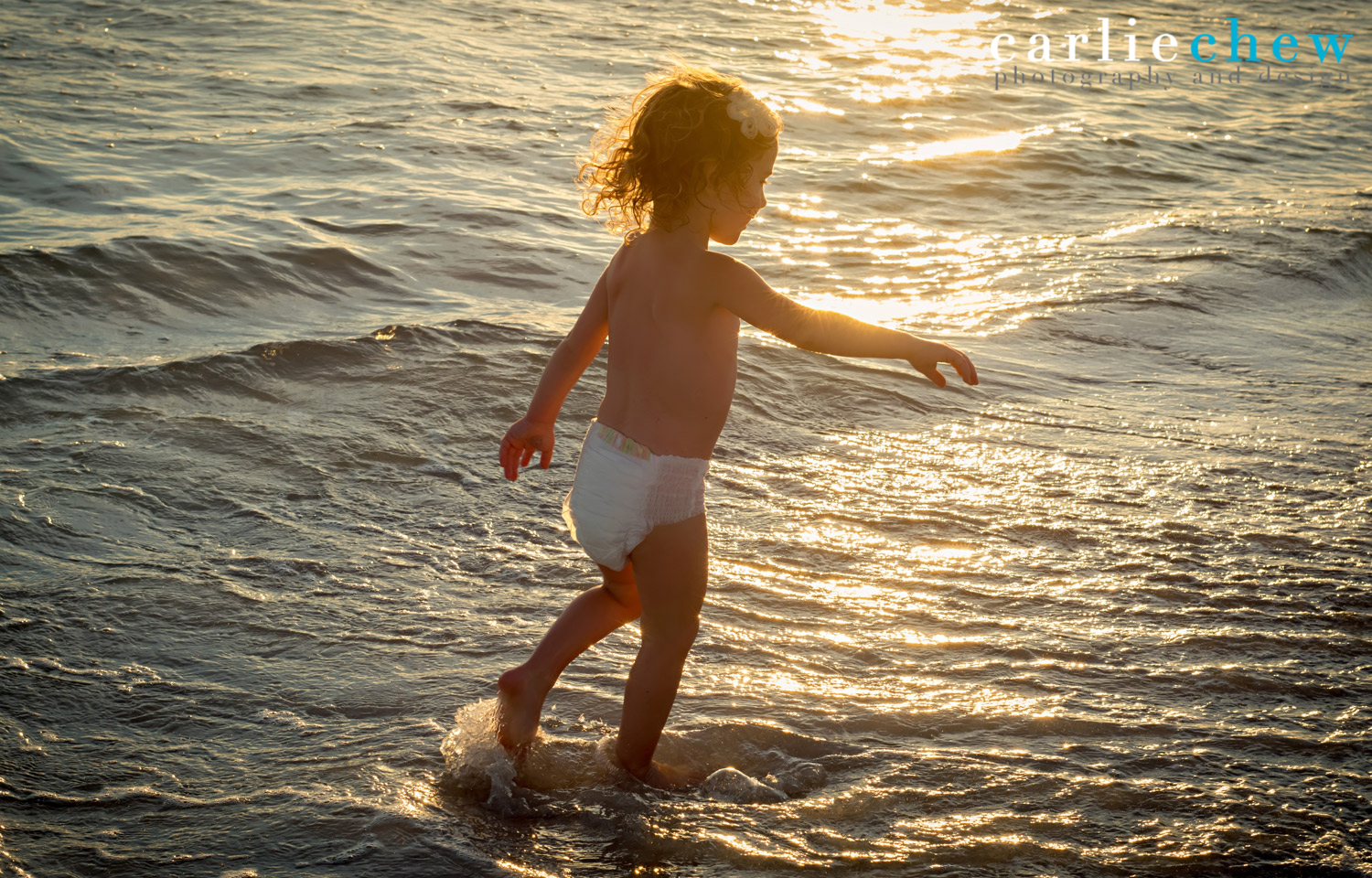 Toddler having fun at sunset photography with Carlie Chew Photography at Anna Maria Island
