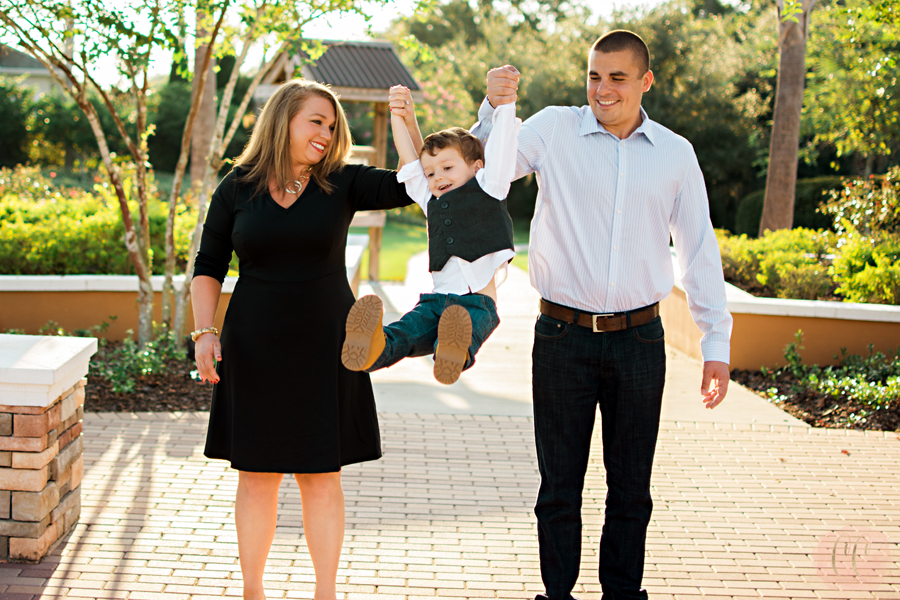 Parents swing son at Fishhawk Ranch in Lithia, Florida taken by family photographer Carlie Chew Photography