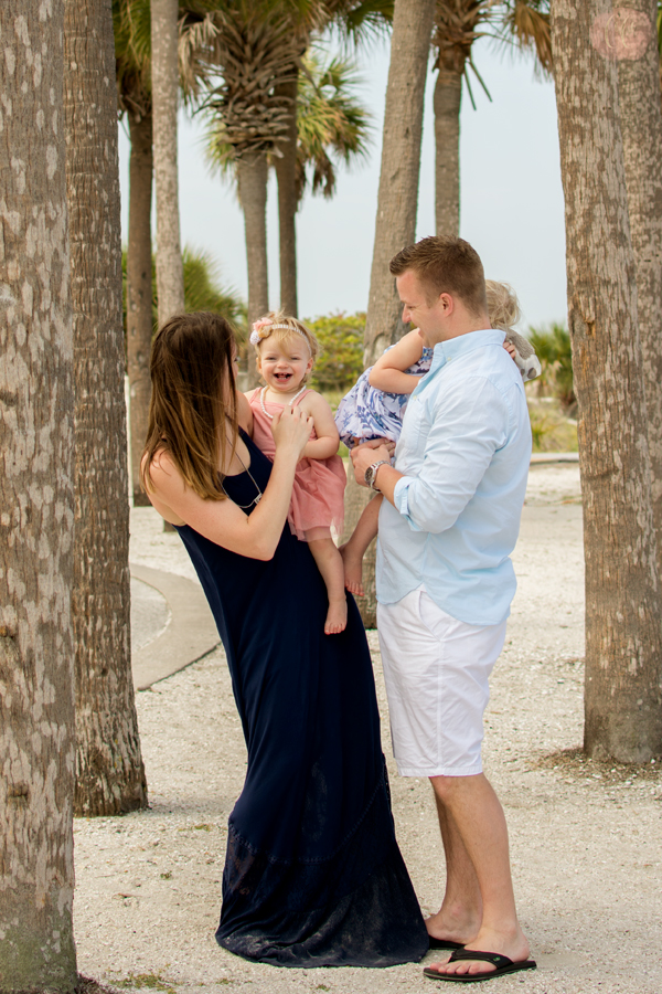 Vacation photographer captures family laughing at beach at Sand Key Park in Clearwater, FL by Carlie Chew Photography