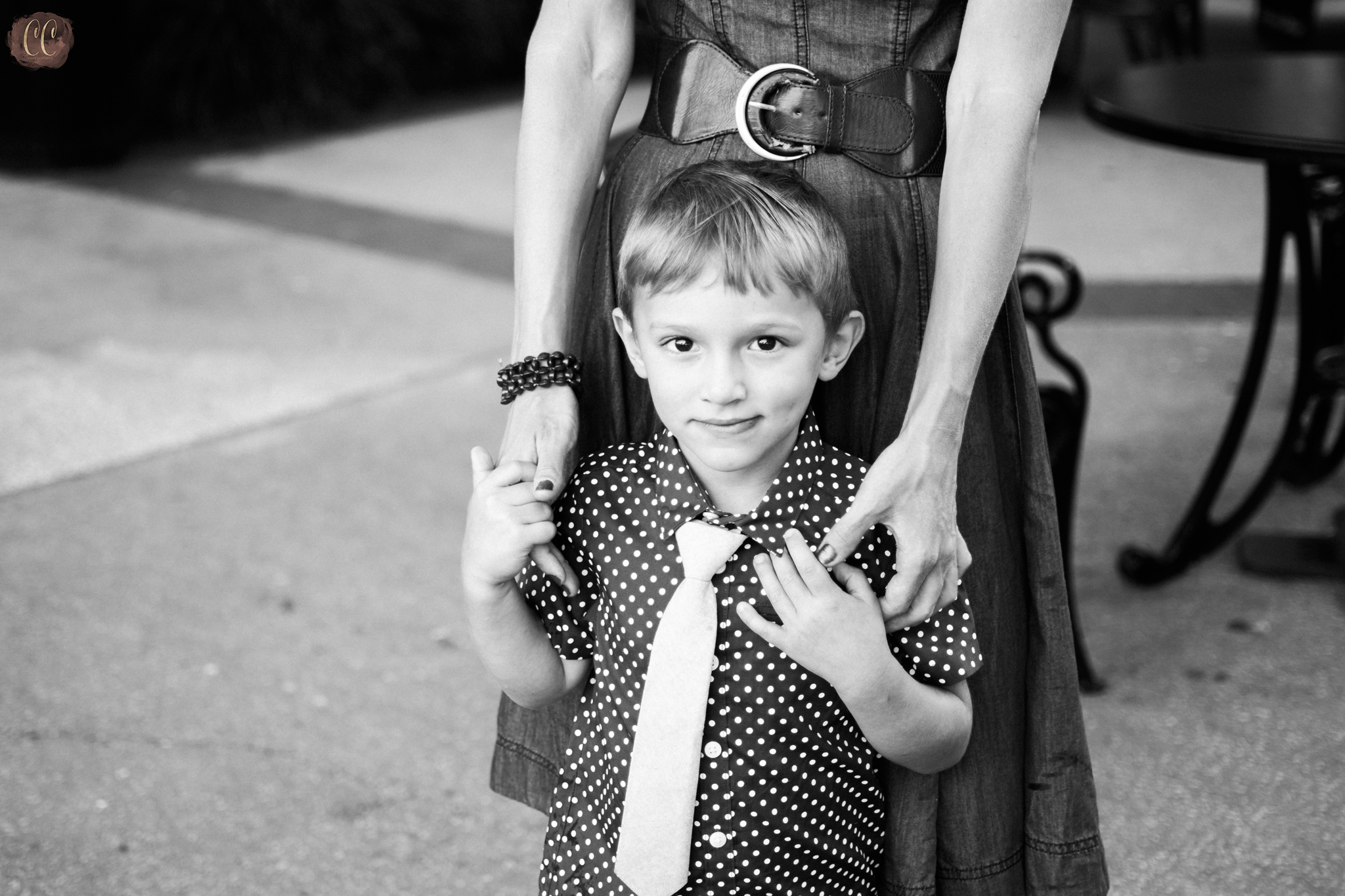 Mother and son hold hands during mommy and me session with family photographer Carlie Chew Photography Tampa