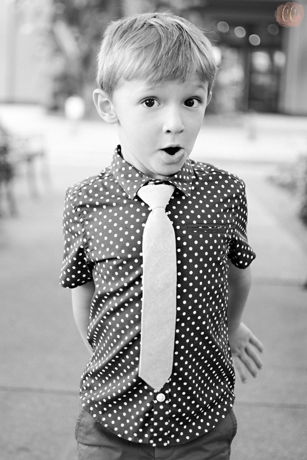Little boy makes funny face at mommy and me session with Carlie Chew Photography in Hyde Park Village, Tampa