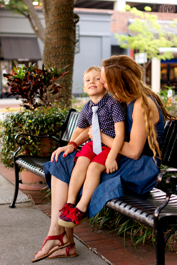 Mom kisses son at mommy and me session in Hyde Park Village, Tampa shot by family photographer Carlie Chew