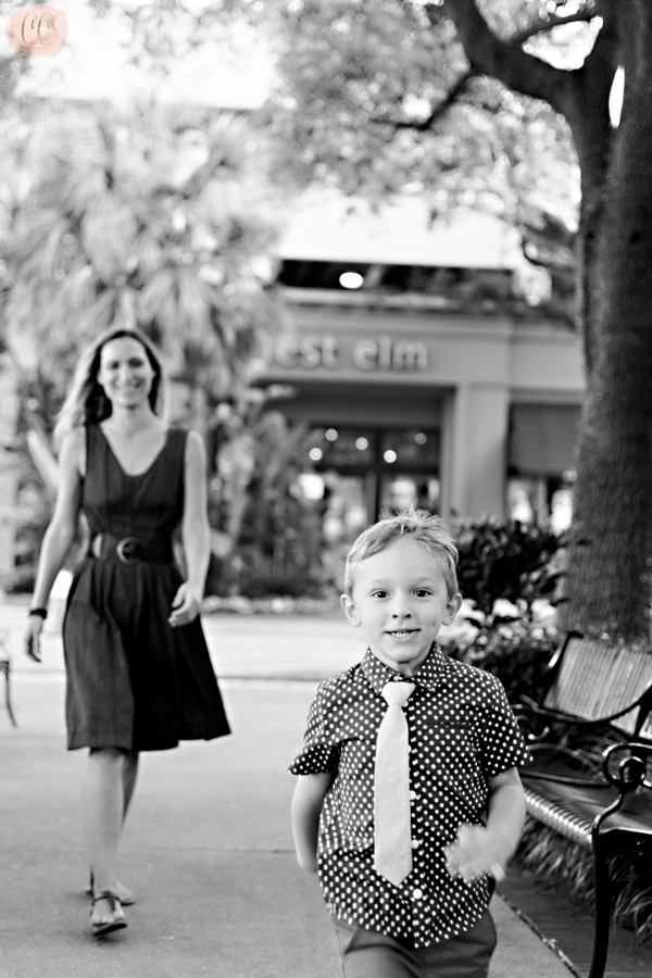 Little boy having fun at mommy and me session shot by Carlie Chew Photography in Hyde Park Village, Tampa