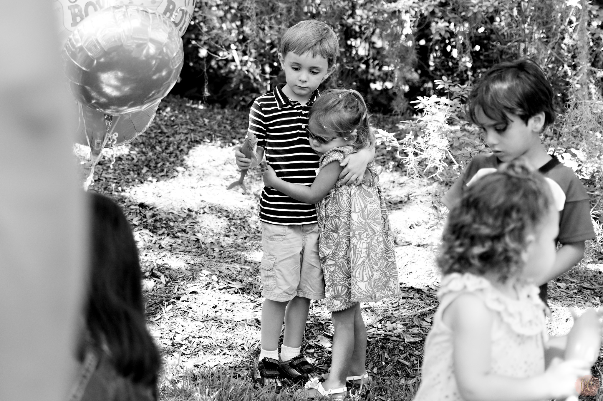 Children that are best friends hug at gender reveal party at The Tampa Yacht Club, picture taken by Carlie Chew Photography