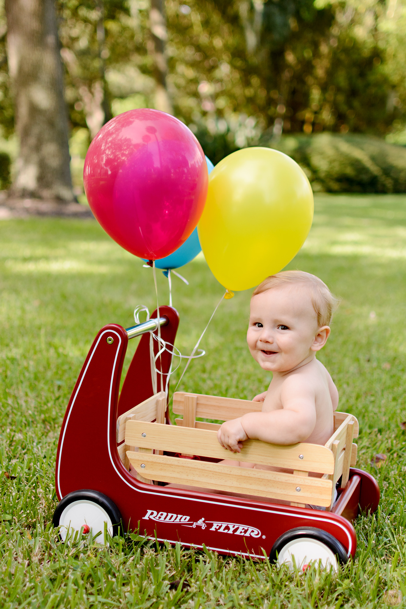 Baby with balloons for first birthday at Plant Park in Tampa, Florida taken by Carlie Chew Photography