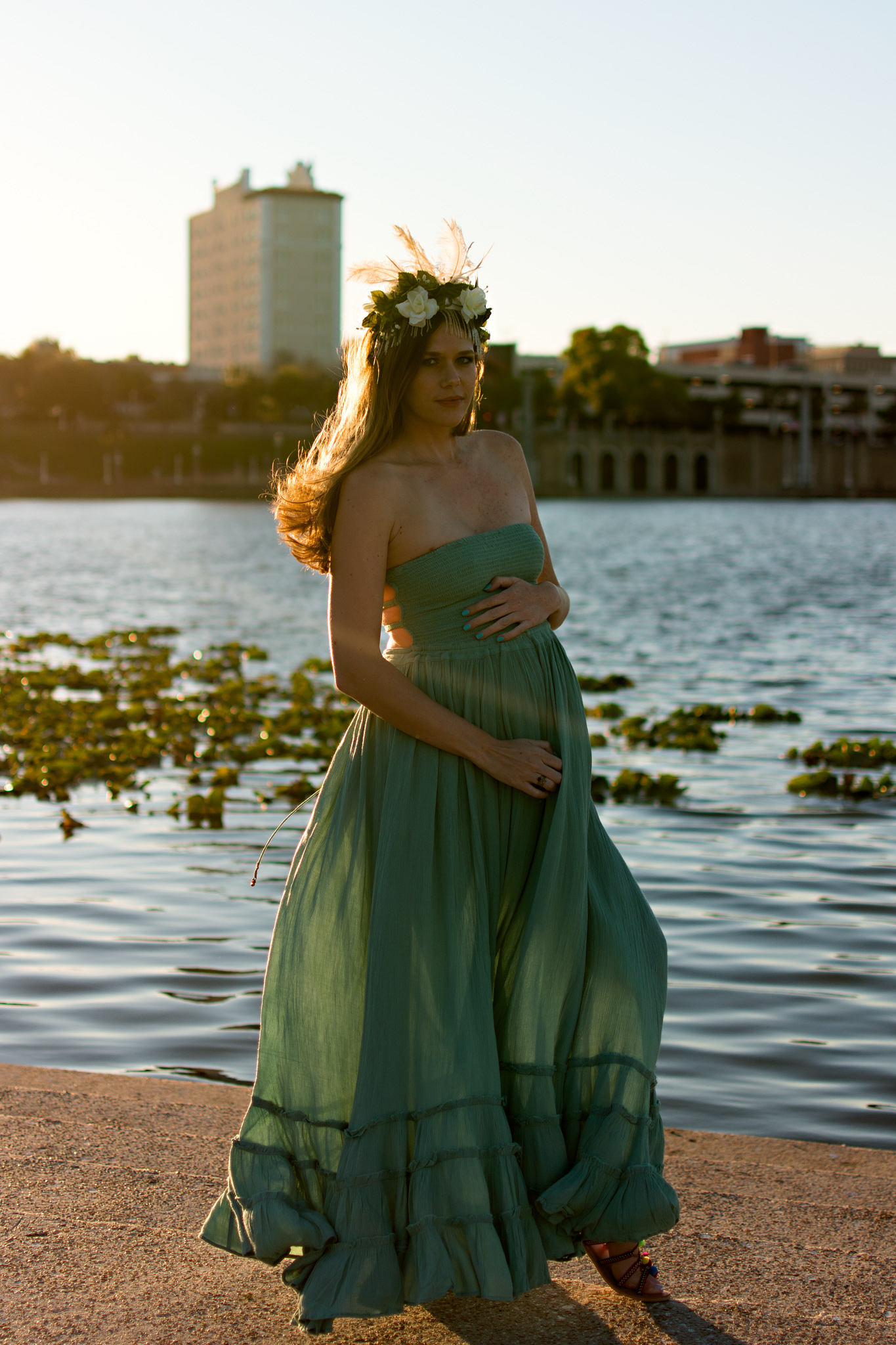 Mom to be with sunset backdrop at Mirror Lake for maternity photos with Carlie Chew Photography in Lakeland Florida