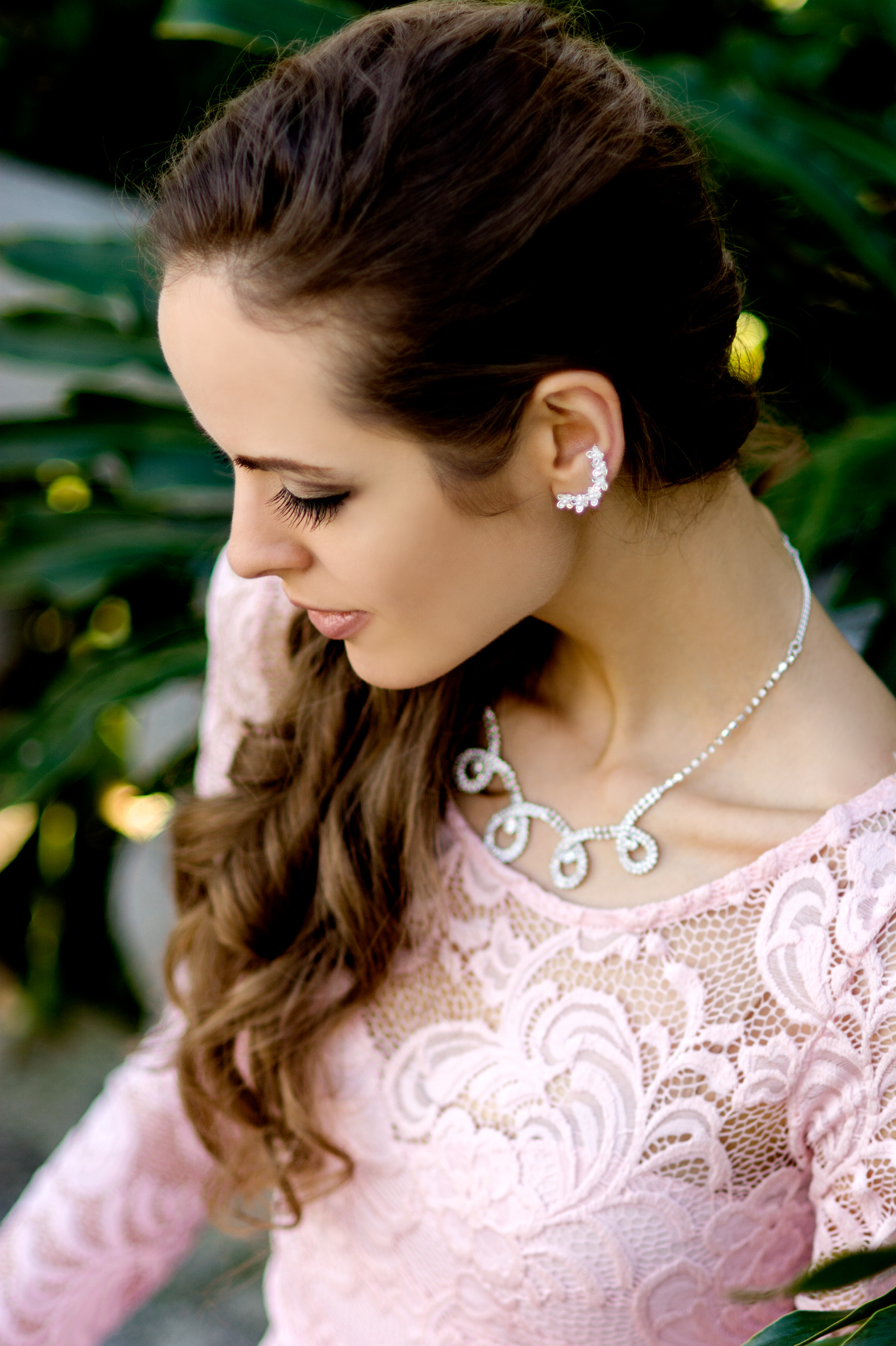 A serene vintage profile shot taken by Carlie Chew Photography in the gardens of historic St. Petersburg, FL