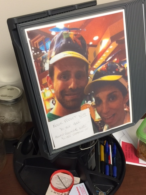 """This is an example of a trigger that my husband has in his office. He is a real estate agent and must keep himself motivated and focused. He uses this picture of us with this note as a trigger to remind him in the office of why he does his job. The note says: """"Never forget why you are here. Always remember what you are capable of."""""""