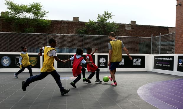 A scrimmage in East New York, led by the coaches at Street Soccer USA.     (Stephen Nessen/WNYC)