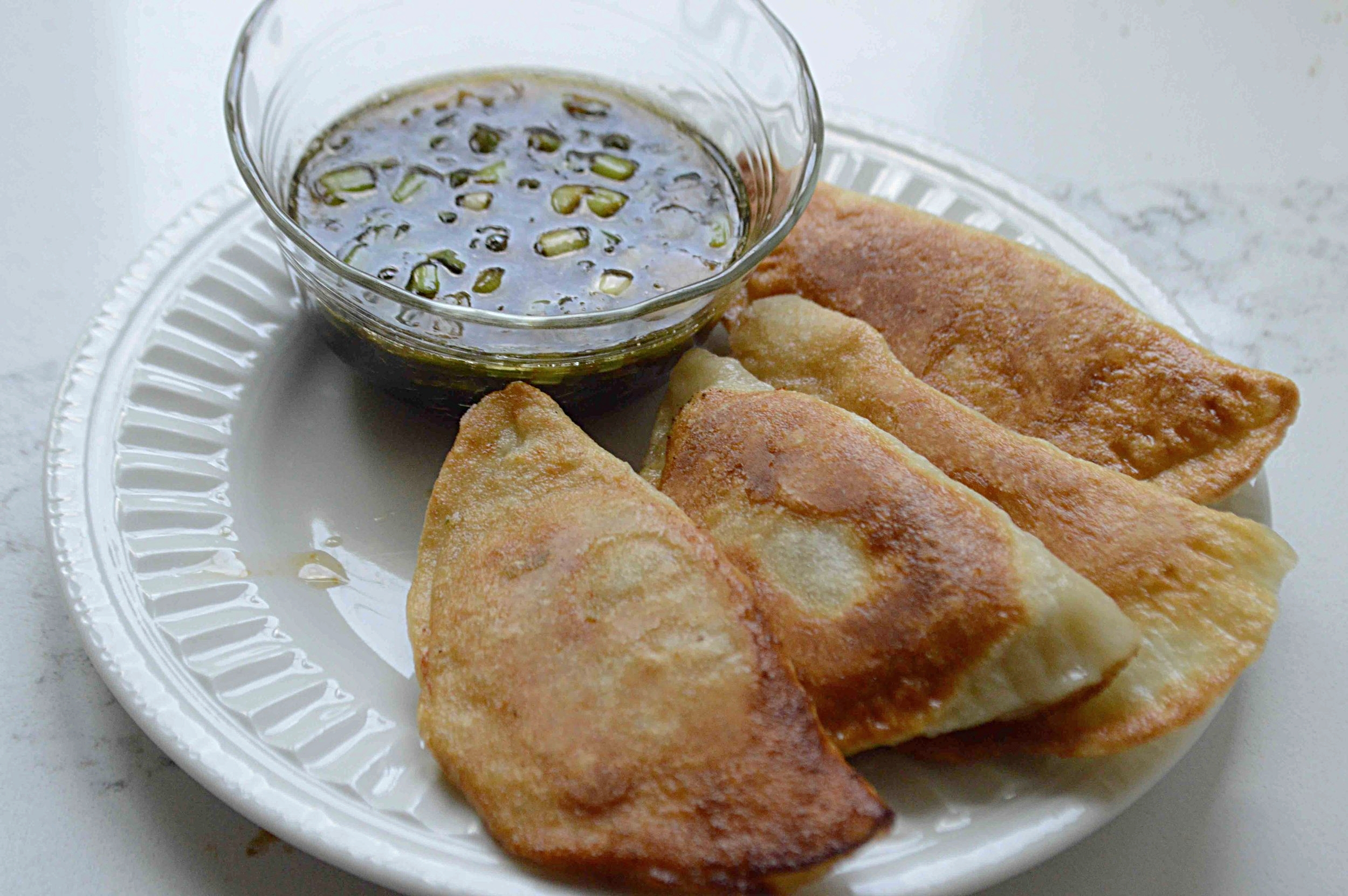 Chicken Potstickers with Spicy Soy Sipping Sauce