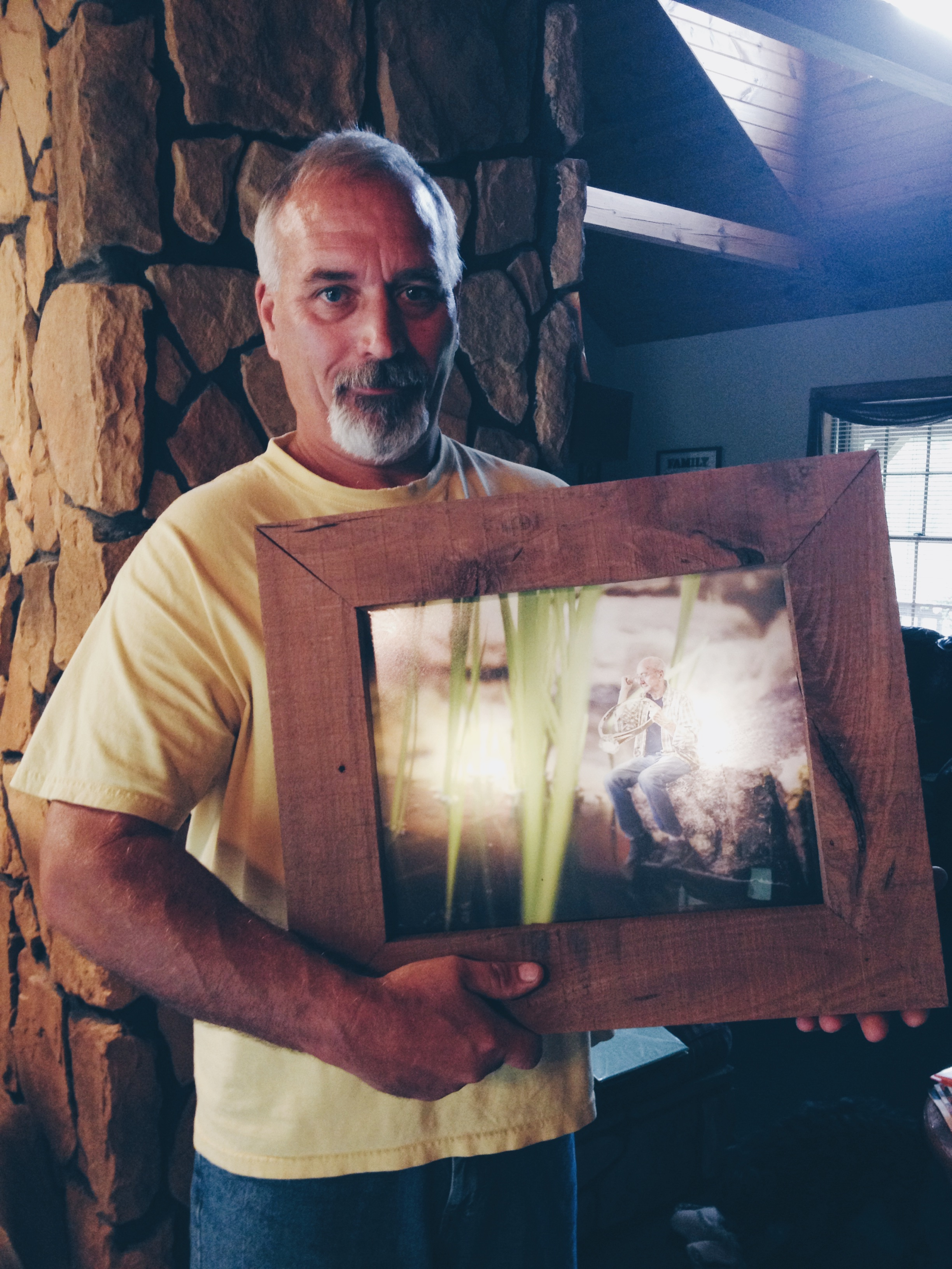 Dad holding the final product after a full week of work on the five frames we designed and he built from scratch.