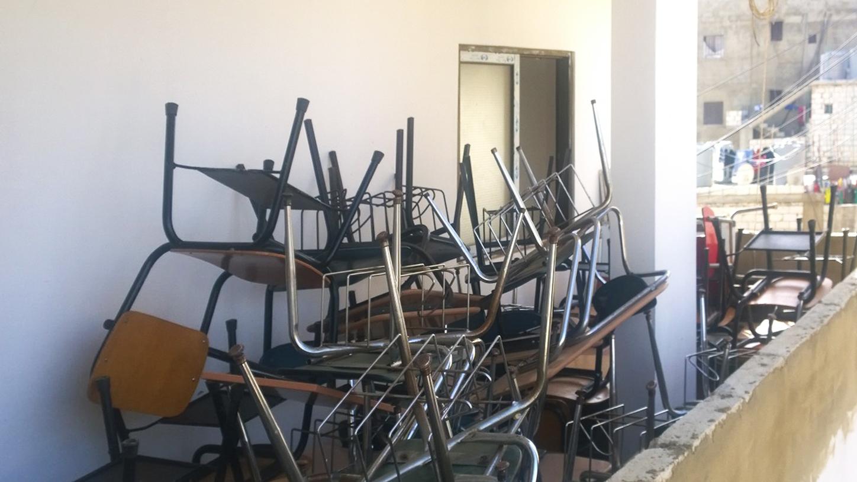 School desks stacked on the balcony