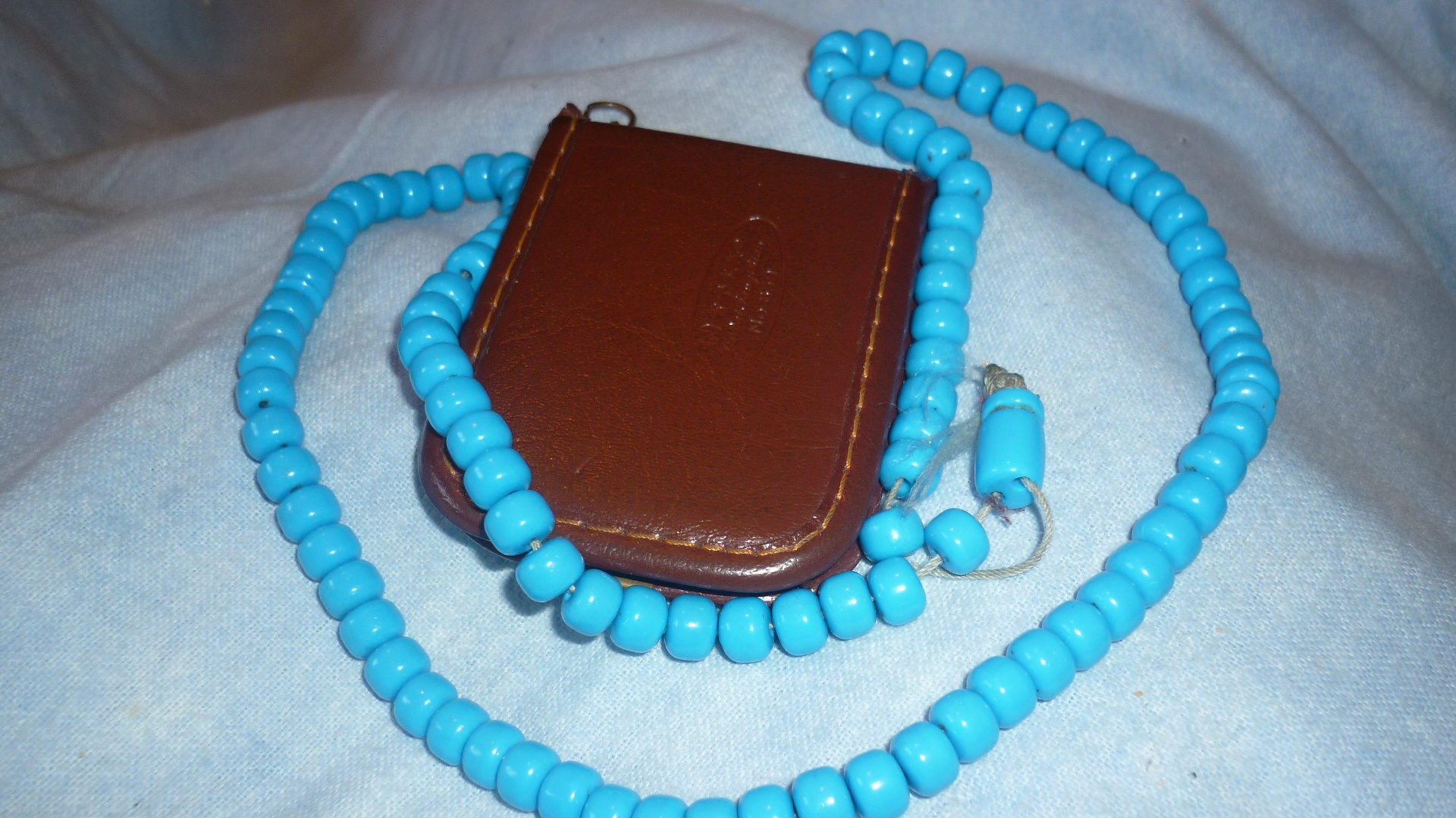 Beads and (closed) phone book