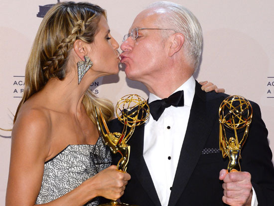 Tim Gunn and Heidi Klum win the outstanding host for a reality or reality-competition program award at the 2013 Primetime Creative Arts Emmy Awards.