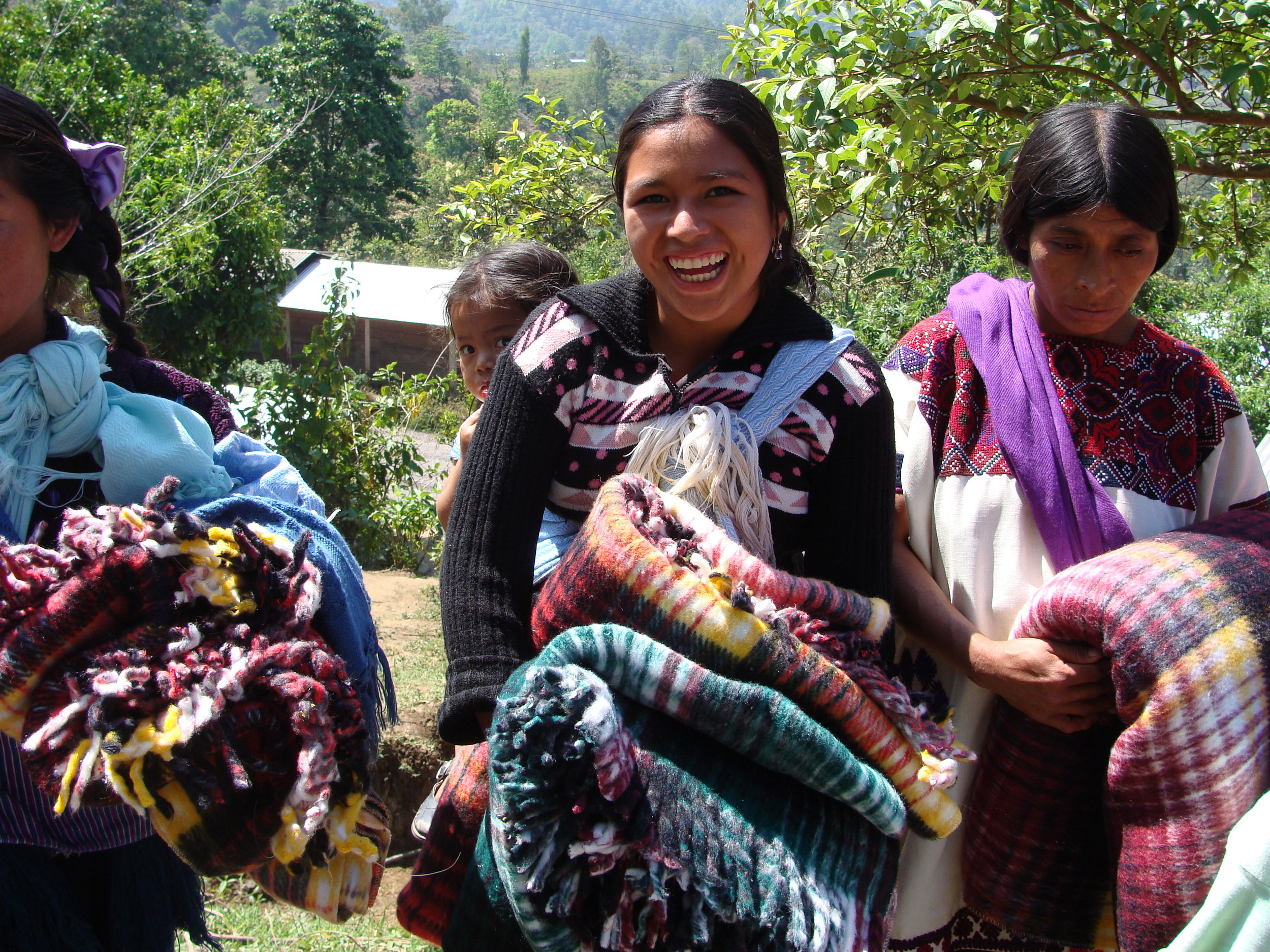 Women from the Chamula tribe with blankets gifted to them by supporters of Mexico Ministries.