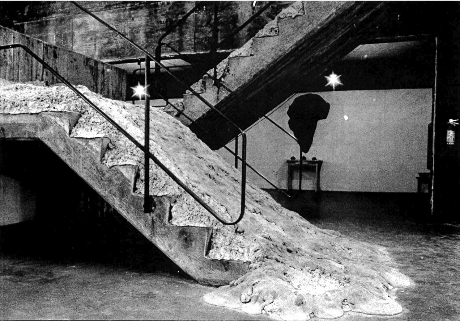 David Ireland,  Smithsonian Falls, Descending a Staircase for P.K. , 1987. Reproduction from original photograph. Courtesy of the Anne Bremer Memorial Library, SFAI.  © David Ireland.