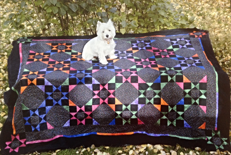 One of Kathy Issacson's quilts from the good old days in Killarney and her Westie, Spike.