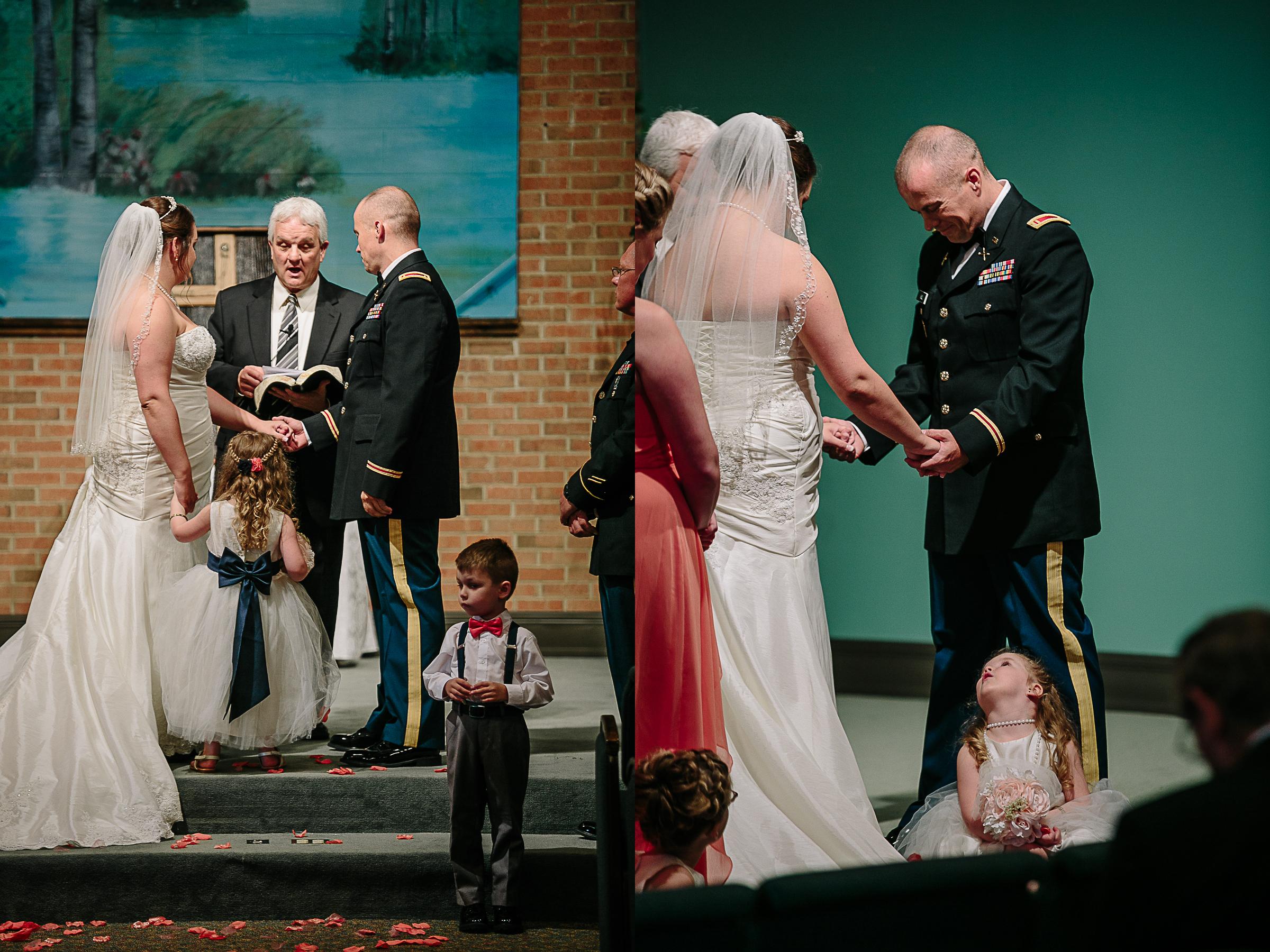Adorable Flower Girl Daughter Looking on as Bride and Groom Get Married.jpg