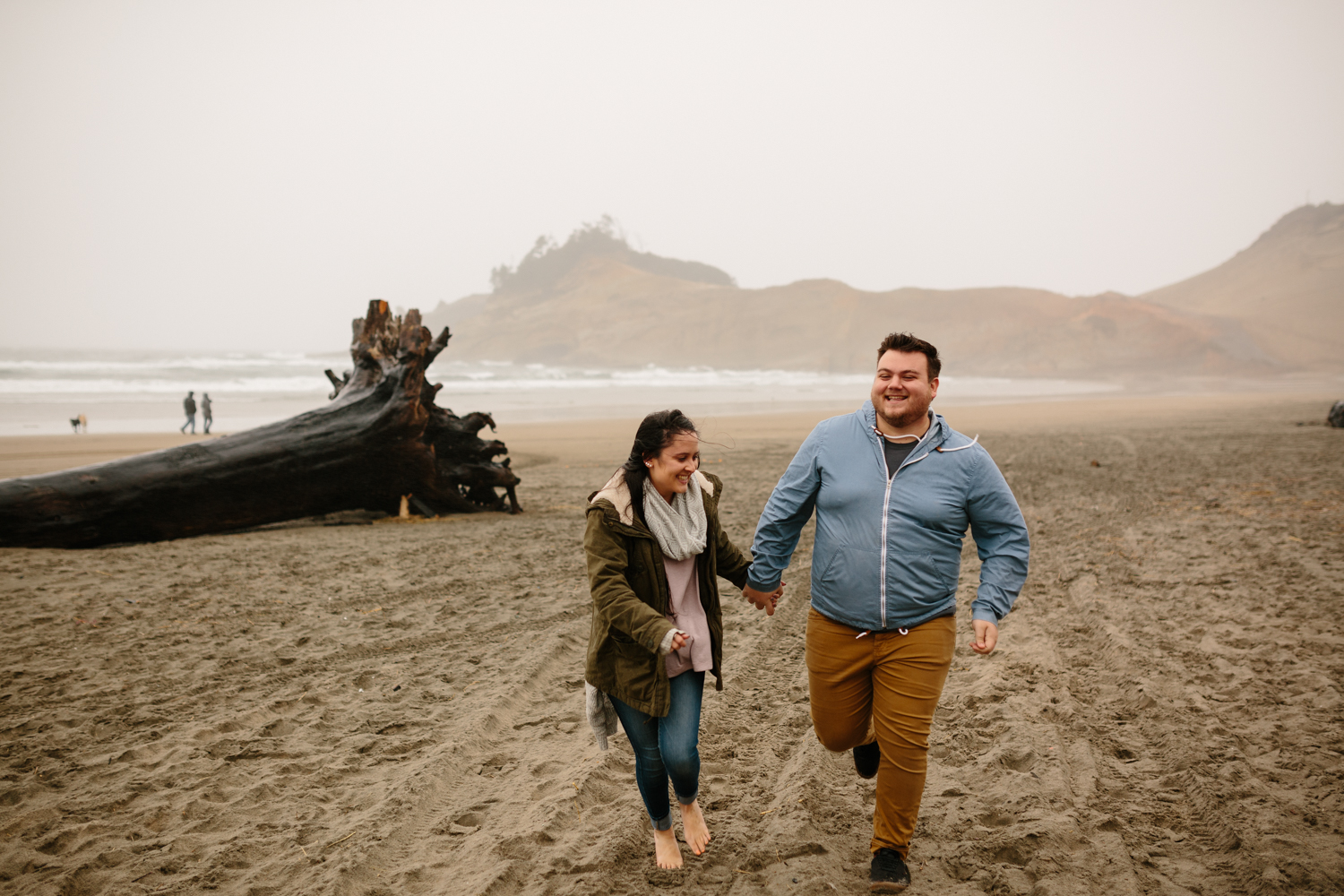 Couple running and laughing on the beach
