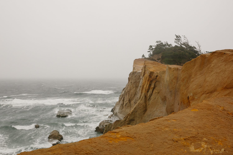 Pacific Ocean waves crashing against cliffs on the Oregon Coast