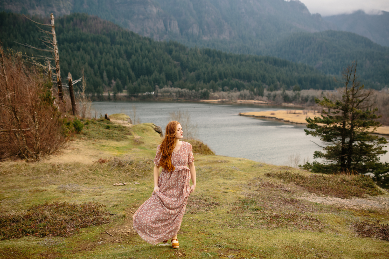 A Beautiful, Red-Haired Pregnant Woman Walking on a Windy Day in