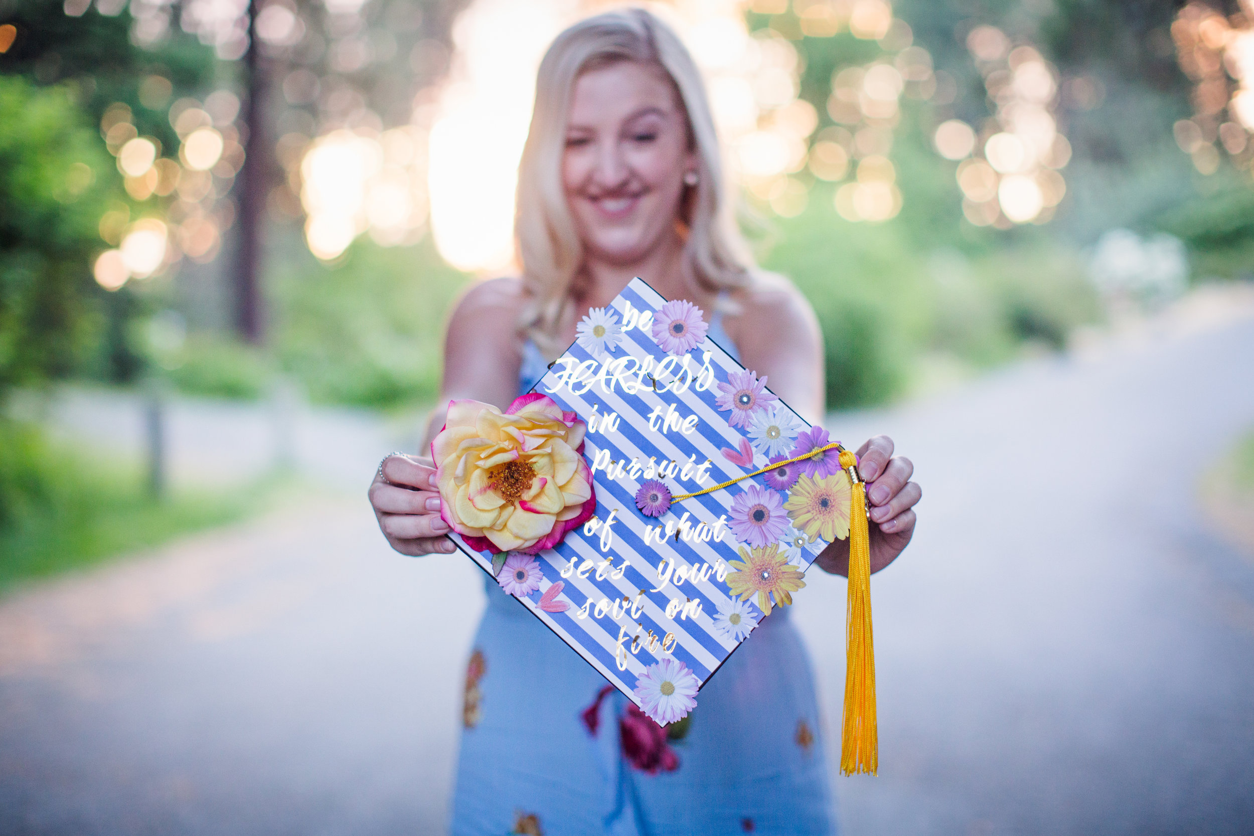 """""""Emily provided me with photos from my graduate school commencement in 2017, and I could not have been happier with the outcome of the photos or with the experience of the shoot. Emily is not only professional and punctual, but extremely skillful in making her clients feel comfortable and relaxed. For someone who doesn't love having her pictures taken, I thoroughly enjoyed myself during our shoot and will definitely be going back to Emily for future photography needs! """" -Hilary H."""