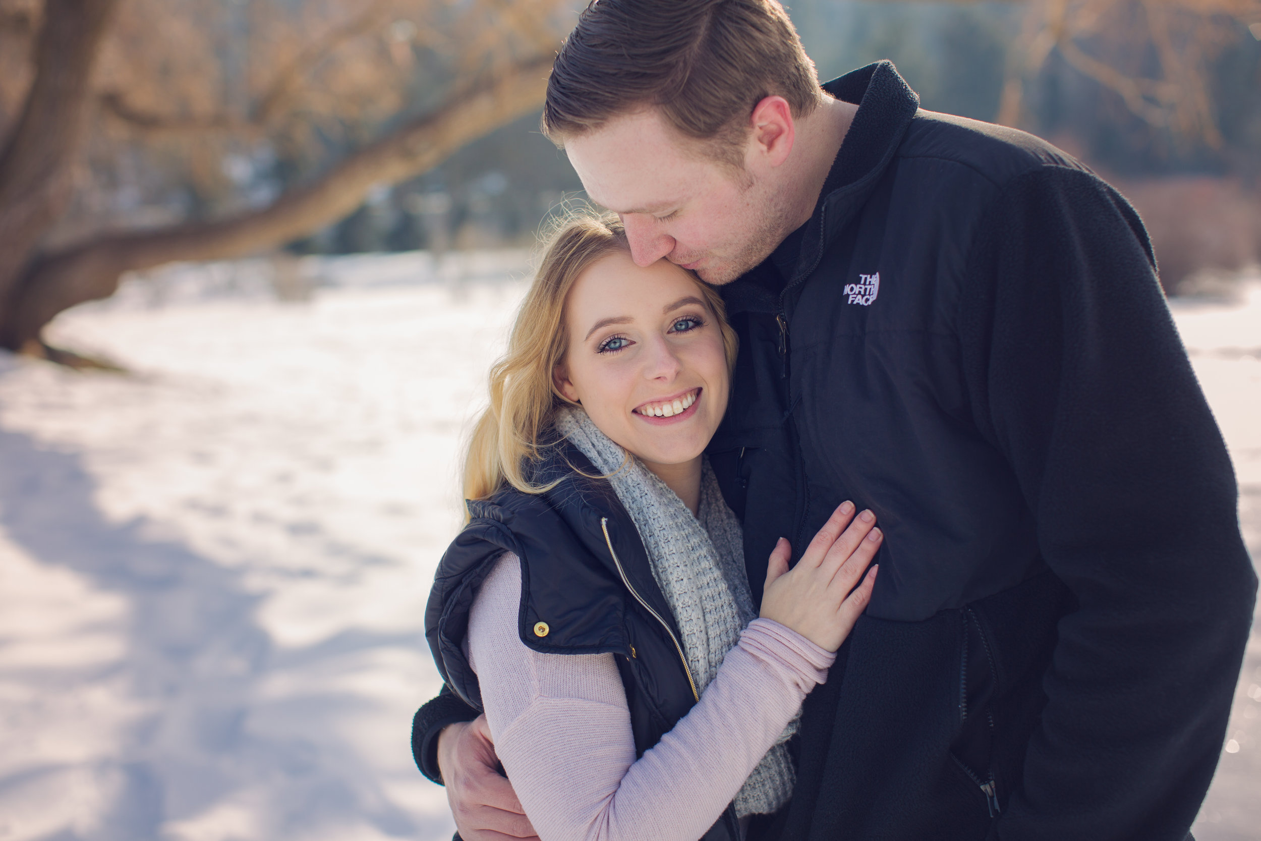 """""""Emily did our engagement photos, she does an amazing job, and is so much fun to work with! Highly highly recommend. She got our edited photos back to us super quick also! Love her!""""  Kaitlyn B."""