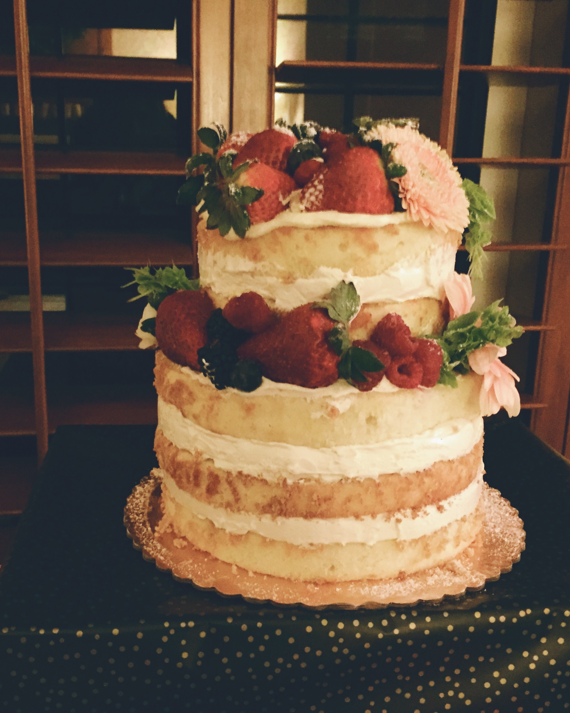 Naked Cake with Raspberry Coulis, Raspberries, and Vanilla Buttercream
